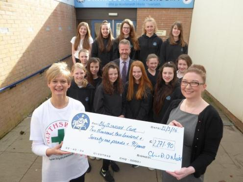 Adrienne Dempster from Blythswood Care receives a cheque from Mrs Heather Macrae for the huge total raised by S1 enterprise groups