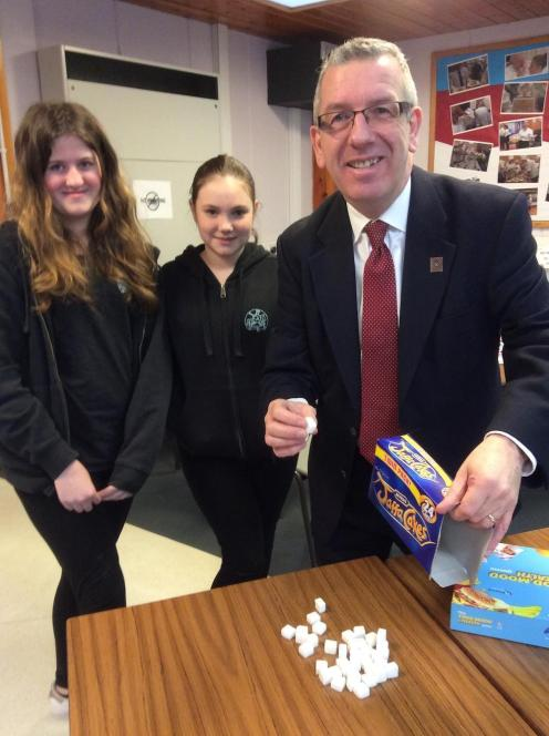 Heather MacDonald (1L2) and Ella Marr (1L2) with David Stewart MSP