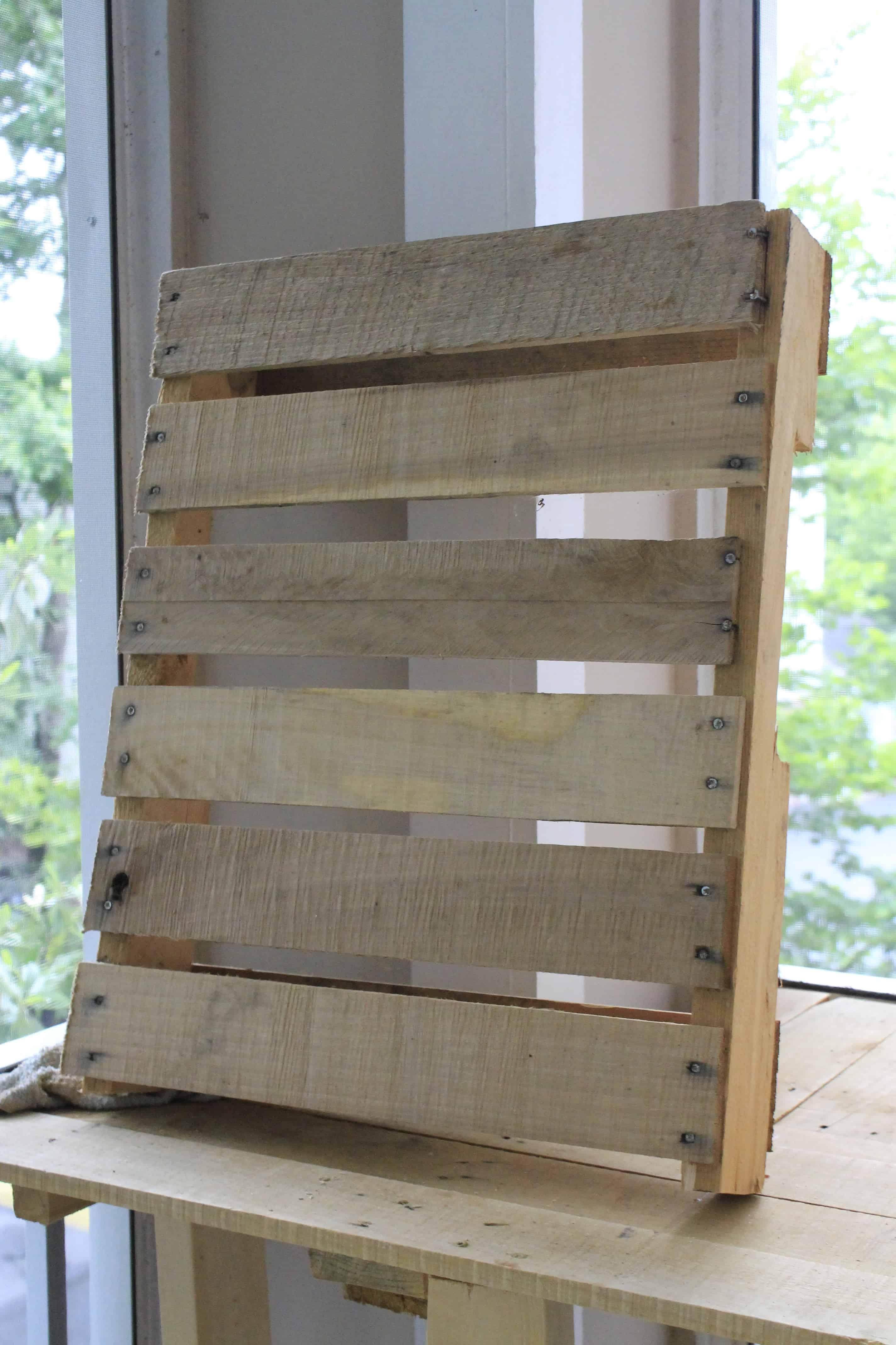Wooden pallet herb garden charleston crafted for Wood pallet herb garden