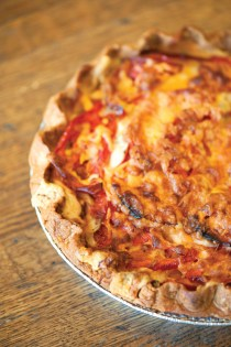 At Dixie Supply, the tomato pie is bursting with Lowcountry flavors. From ripe tomatoes to a pie crust rolled with love, this dish is one of our favorites!