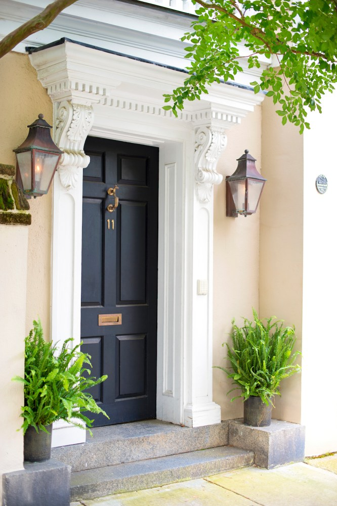 A WALK ABOUT TOWN: Take a leisurely stroll through Charleston's Historic District to spot abodes adorned with flickering copper carriage lanterns and greenery.