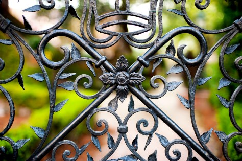 PEEK INSIDE: Festooned with wrought iron gates, Charleston gardens invite a peek within.