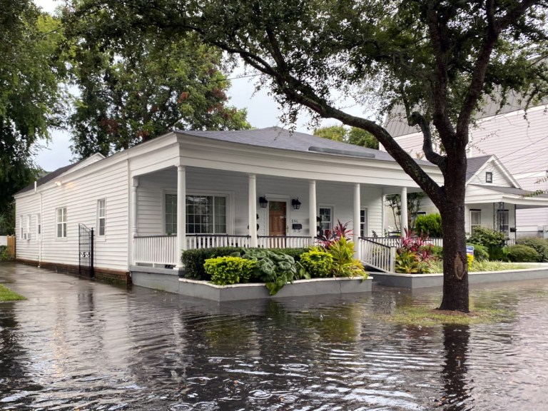 A home in Charleston with street flooding