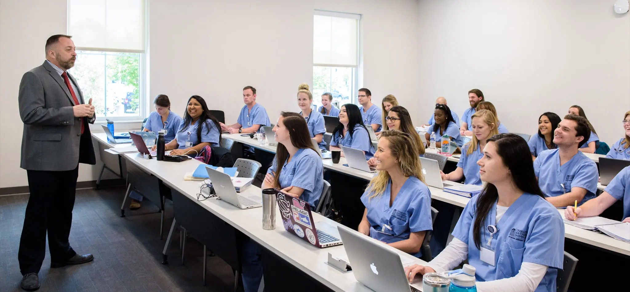 Physician Assistant classroom with a professor speaking at the front of it.