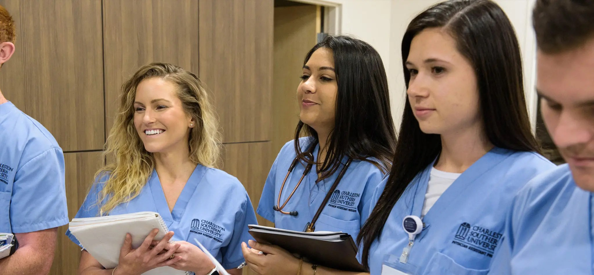 Three female Physician Assistant students learning in a medial office.