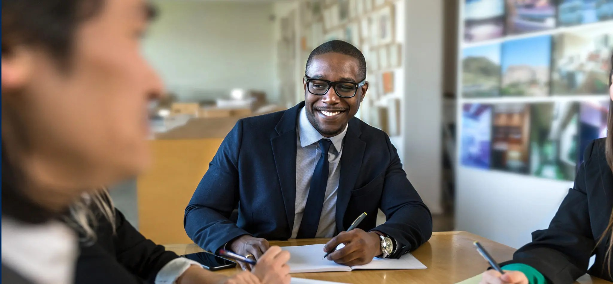 African American executive businessman at work after earning a MBA degree.