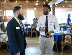 Christian Hanley speaks with attendee at CSU Comes to You