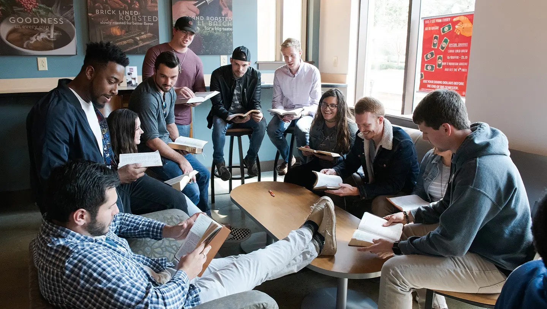 CSU students gathered in Java City coffee shop having a bible study at Charleston Southern University