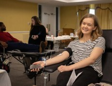 A CSU student donating blood on campus.