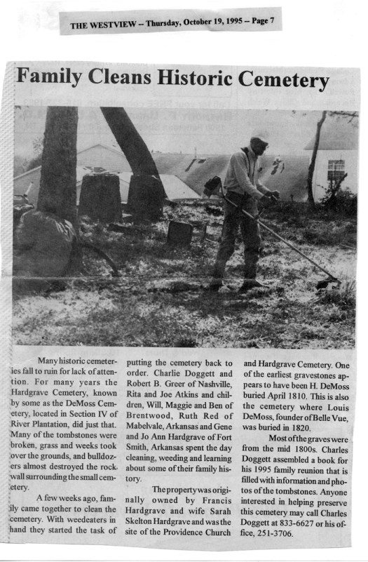 Paper article, family cleans cemetery