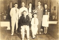 Everett in a Wedding Party? 1937-38? Warren, Arkansas -- This looks like he was part of a wedding party, maybe he was a groomsman or sang in the wedding. Dad worked for a hotel in Warren and this could have been made there with the staff, but it looks more like a wedding party photo with the flowers. I am pretty sure that none of these are relatives, at least not his brothers and sisters. Everett-UnknownGrp-ca37-38.jpg