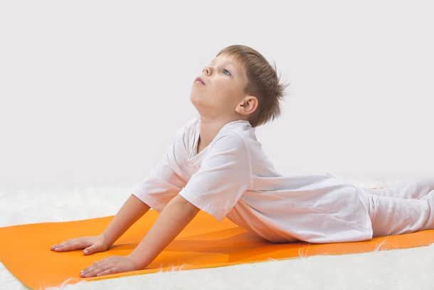 Children S Yoga The Little Boy Does Exercise
