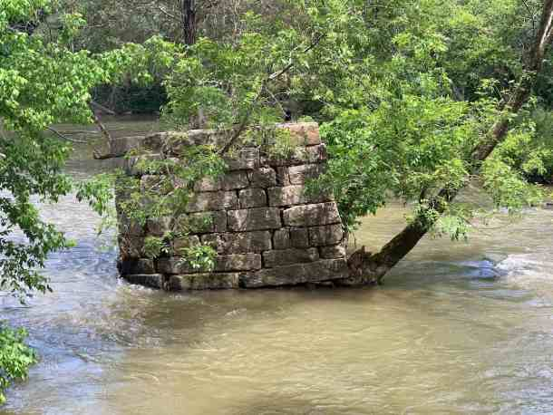 Remnants of old stone bridge in South Fork of Catawba River