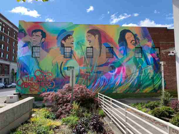Colorful mural of The Avett Brothers on a wall of a building in Concord, NC