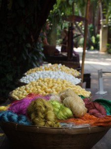 fresh cocoons, cooked ones and ready spun thread
