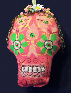 Soft Dia De Los Muertos Skull made using discharge paste, embroidery, fabric paint, and embellishments