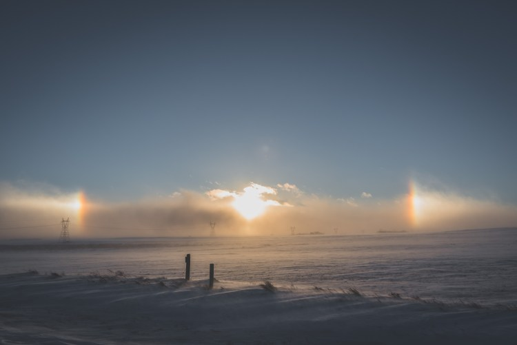 North Dakota's Winter Weather | North Dakota'swinter weather is incredibly unique and unlike anywhere else I have been. | Chasing Departures | #winter #weather #sundogs #frozen #snow #northdakota #travel #photography