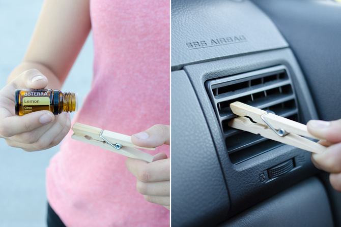 A clothespin with essential oil attached to a car vent