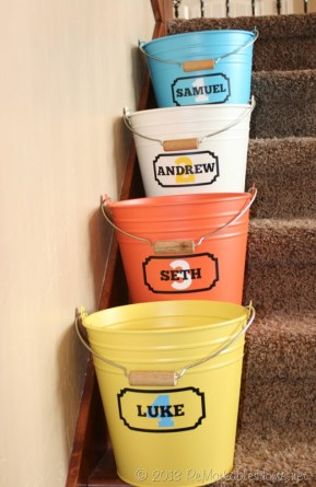 Four dollar store buckets sat on consecutive stair steps.