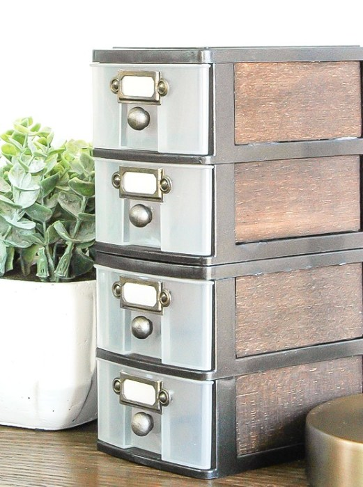 Plastic storage drawers painted in an industrial farmhouse style.