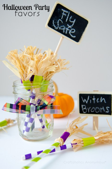 Mini homemade witch brooms tucked inside a glass mason jar.