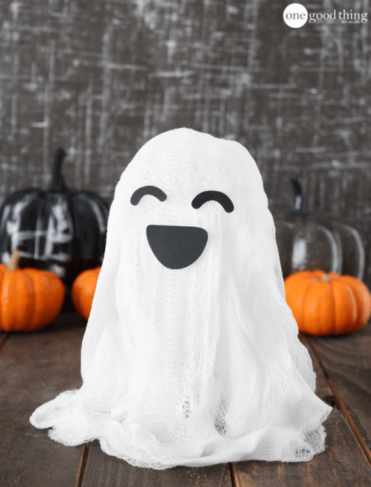 A cheesecloth draped over to form a smiling ghost figure.