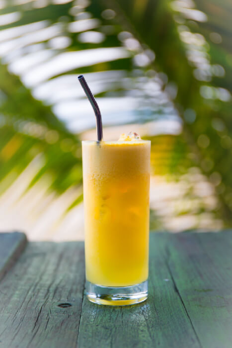 A glass of orange juice, which is not a keto-friendly drink