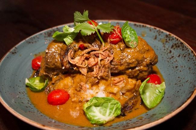 "Massaman Short Rib Curry – Braised short rib, peanuts, eggplant, served with sweet potato and Thai jasmine rice ""grits"""