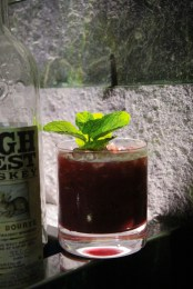 Western Smash, made with High West Rendezvous Rye, fresh mint, blackberry purée, lemon juice and simple syrup
