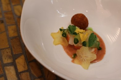 Alaskan King Crab served with umeboshi butter, Asian pear, star fruit and Thai Basil