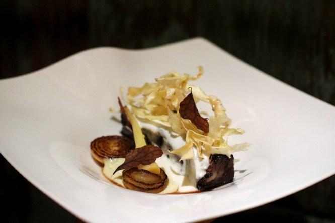 Grilled Short Rib in a sesame glaze served with black garlic, Swiss chard, tamarind and lemon balm