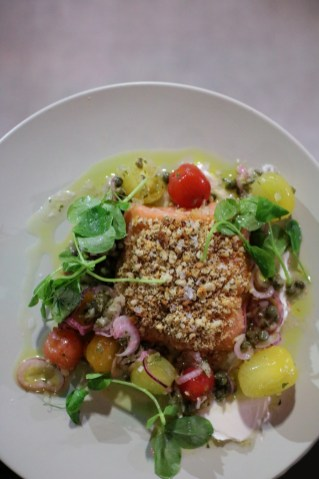 Coho Salmon with an everything bagel crust, fromage blanc, concasse tomatoes, caper vinaigrette;
