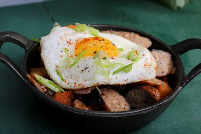 Duck & Foie Hash with roasted peppers, sweet onions and sunny side up egg