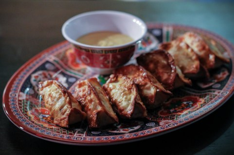 Pretzel Pork and Chive Dumplings served with spicy mustard dipping sauce