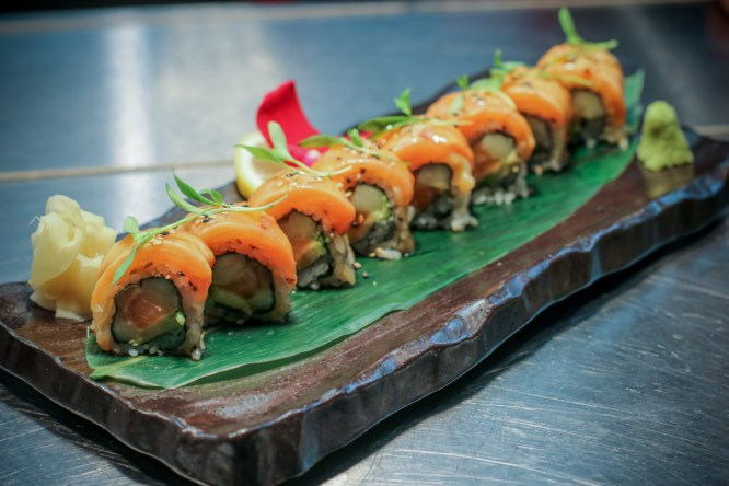 NaiYara Roll made with salmon belly, cucumber, avocado, scallion, truffle oil