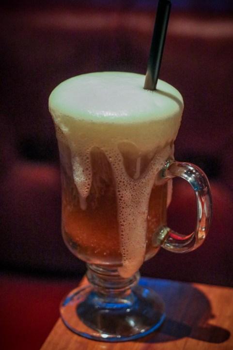 Thairish Coffee with Irish whiskey, thai coffee, kelvin black tea, cardamom foam