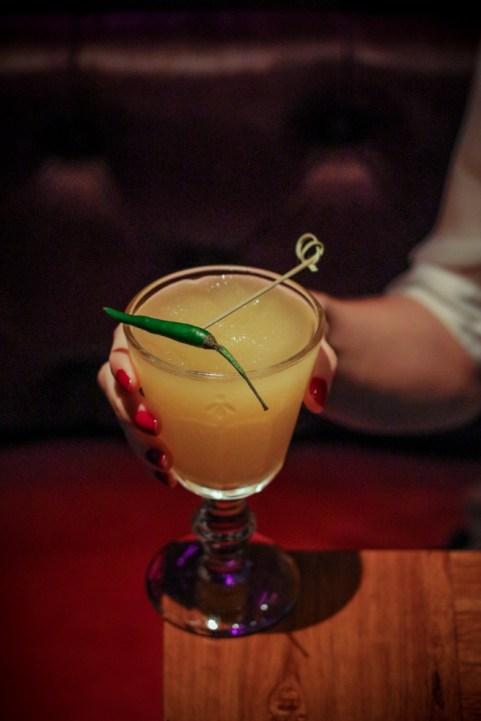 Killer Bee made with gin, kelvin lemon, Thai chili, lemongrass, ginger