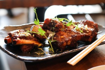 Sweet and Sour Ribs made with a house blend SS, micro radish and yuzu zest