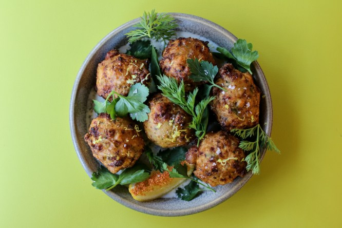 Conch Fritters made with citrus yogurt and celery jalapeño