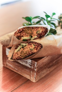 Raw falafel, red quinoa, cucumber, red pepper hummus, tzatziki