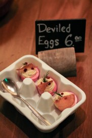 Drunken Deviled Eggs with pickled roots & sunchoke chips
