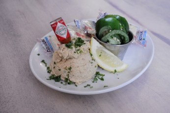 Florida Fish Dip - Our dip is made with in-house smoked Florida grouper and local white fish, served with saltines and jalapenos.