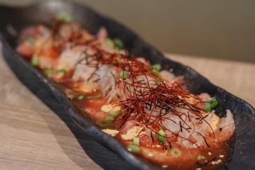 Tiradito nikkei, tamarind, eel mayo, sesame, white radish