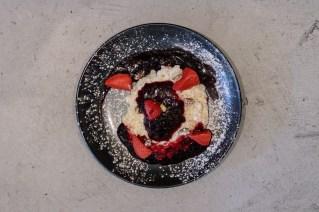 Arroz con leche and mazamorra morada, pistachios and roasted strawberry