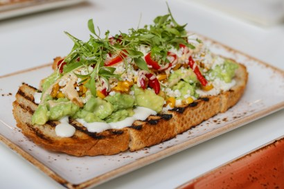 Avocado – Chipotle / jalapeno crema – cotija – lime – charred corn – pickled fresnos