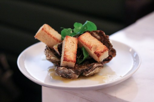 Broiled Oysters – Grana Padano, Roasted Cabbage & Oregano Butter
