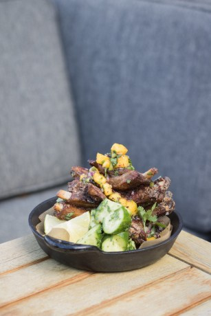 Spicy Adobo Pork Ribs w/ sour mango & habanero salsa, cucumber, lime