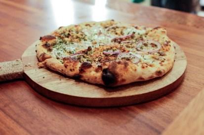 Pistachio Pizza topped with fontina, stracciatella and red onion