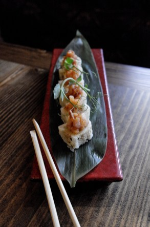 Hamachi G Roll with crispy garlic, cucumber, avocado and chili oil