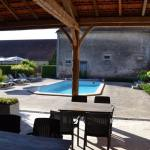 Heated pool and roofed terras at Les Bardons